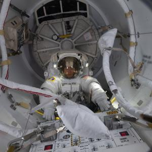 Christina Koch in the airlock of the International Space Station